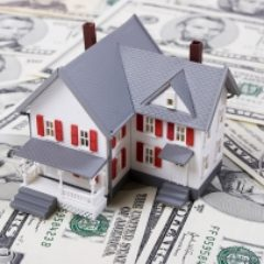 toy-house-on-paper-money-GettyImages-121276818-1300w-867h