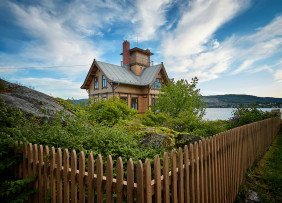house-with-a-fenced-yard-on-the-water-vidar-nordli-mathisen-nGA6aQebrLw-unsplash-1300w-867h