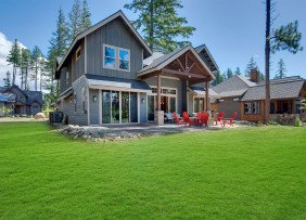 Pacific Northwest house with backyard fire pit and chairs