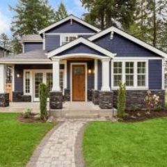 dark-gray-house-white-trim-GettyImages-856794670-1300w-867h