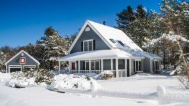blue-house-with-white-trim-in-winter-snow-GettyImages-539306395-1300w-867h