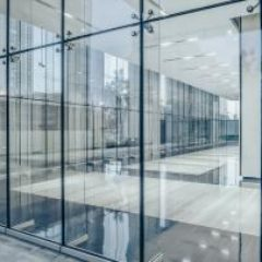 commercial-building-corridor-seen-through-glass-walls-GettyImages-1133174991-1300w-867h