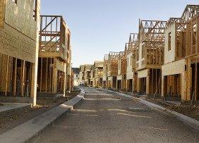 Street view of construction of a housing development
