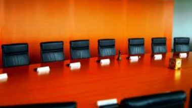 conference-room-orange-wall-GettyImages-595776771-1300w-867h
