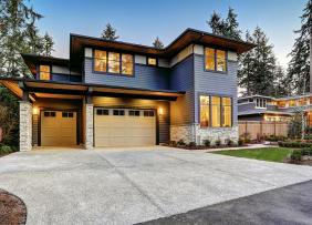 modern-blue-gray-house-with-lights-on-GettyImages-640183848-1300w-867h_0