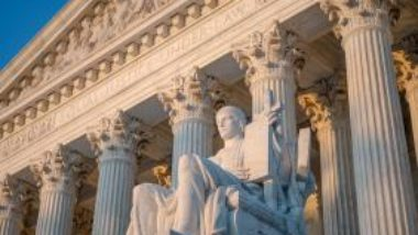 us-supreme-court-statue-and-pillars-GettyImages-1167833543-1300w-867h