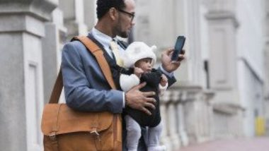 businessman-with-briefcase-bag-phone-and-baby-GettyImages-722208811-1300w-867h