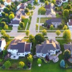 suburban-neighborhood-GettyImages-825271528-1300w-867h